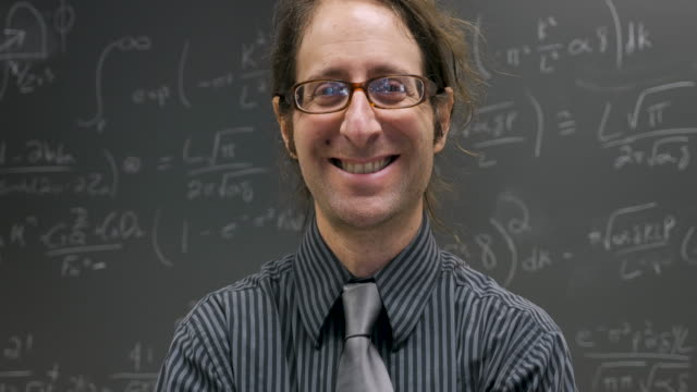 Happy smiling professor, scientist, or math genius looking at the camera