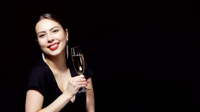 happy smiling woman with glass of champagne - rossetto rosso video stock e b–roll