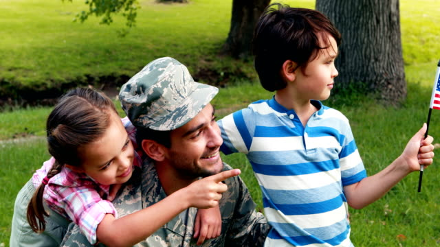 Happy soldier reunited with his son and daughter video