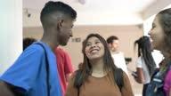 istock Happy students talking in the school's corridor 1285305366