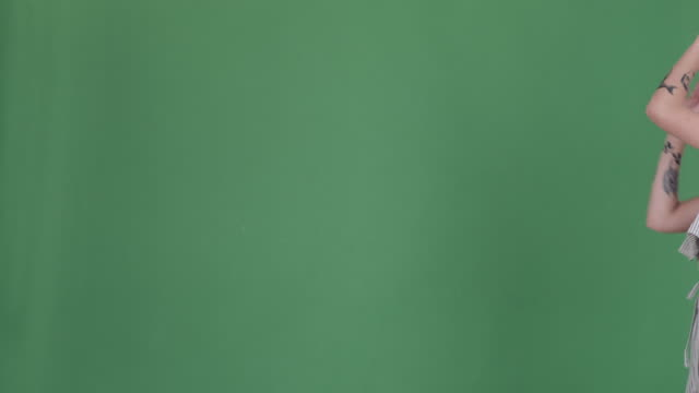 happy tattooed woman dancing over green screen - comparsa video stock e b–roll