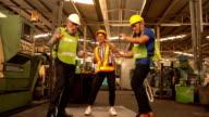 istock Happy Team Of Engineers dancing 1208631122