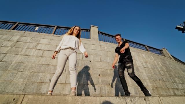 Bидео Happy teens near the wall.