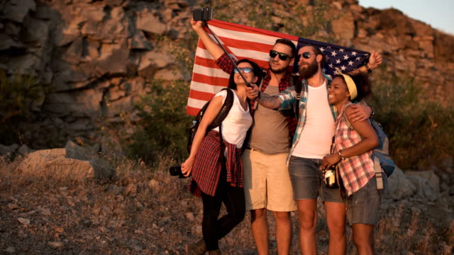 Happy travelers taking selfie with flag video