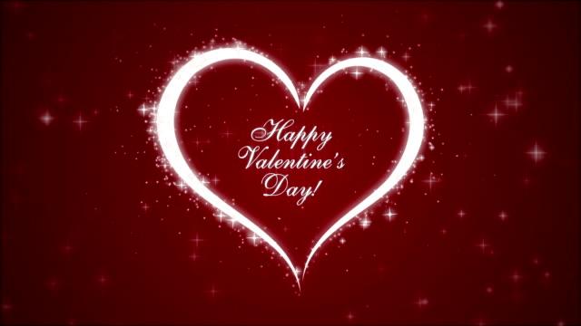 Heureuse Saint-Valentin avec cœur et particules incandescentes - Vidéo