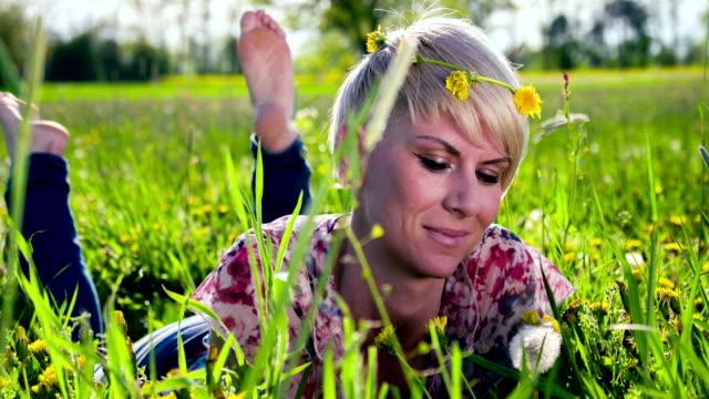 HD DOLLY: Happy Woman Blowing Dandelion video