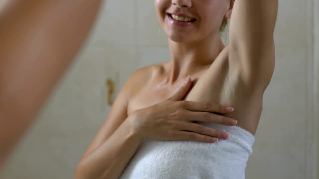 Happy woman checking skin on armpit, good depilation, hygiene and healthcare video