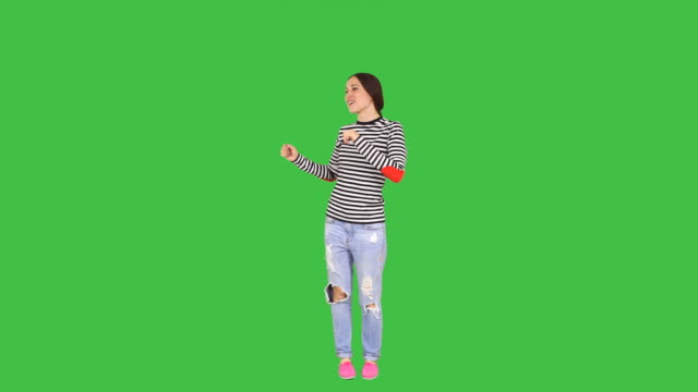 Happy Woman dancing Woman in casual clothes dancing on green screen background with alpha channel full length stock videos & royalty-free footage