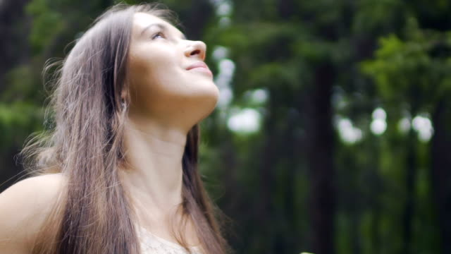 happy woman deeply connected with nature feels unity smiling in forest outdoors - woman portrait forest video stock e b–roll