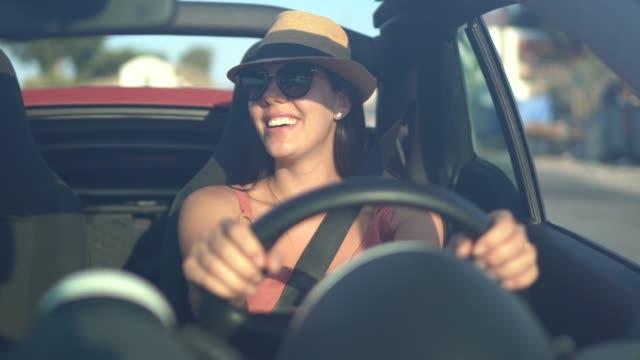 Happy woman driving car, enjoying vacations