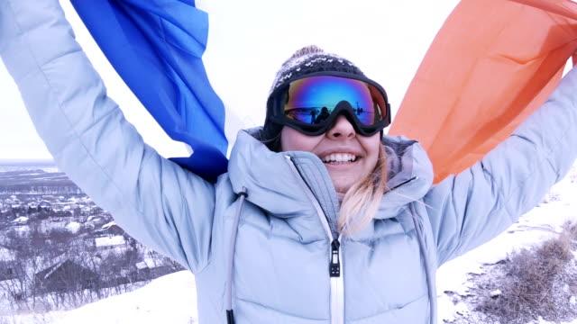 Happy woman fan holding France flag
