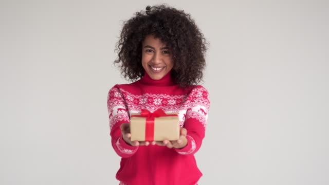 Happy woman holding Christmas gift box