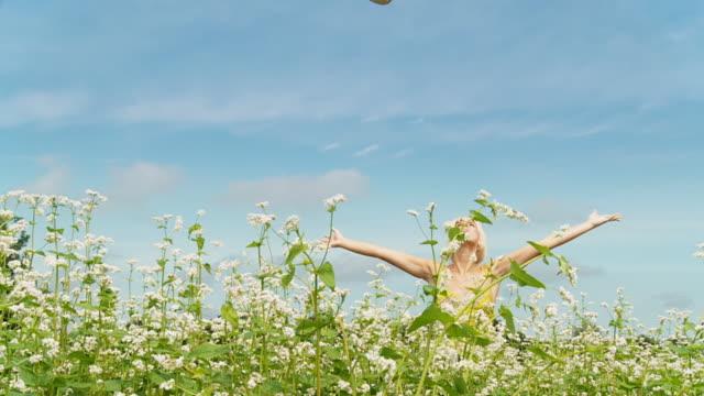 HD DOLLY SLOW-MOTION: Happy Woman In A Buckwheat Field video