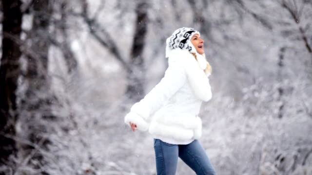 Happy woman in a winter park. video