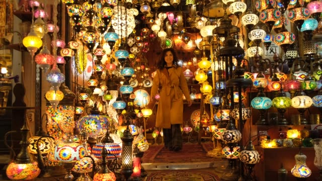 Happy woman in the grand bazaar Young Turkish Girl Shopping in Grand Market souvenir stock videos & royalty-free footage