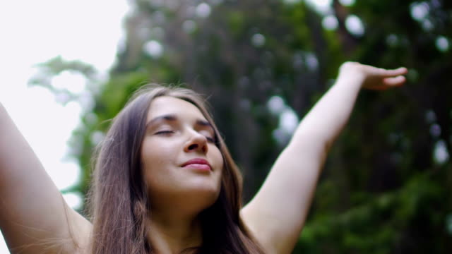 happy woman raises hands up feeling nature around, happiness joy of life slow - gente serena video stock e b–roll