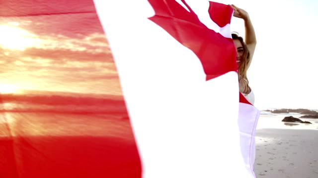 happy woman running with waving canadian flag - canada flag stock videos & royalty-free footage