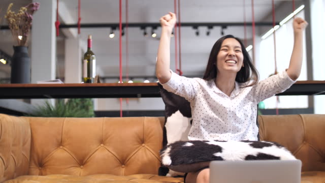 Happy Woman watching tv in living room video