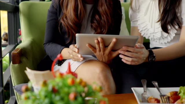 Happy women on digital tablet video