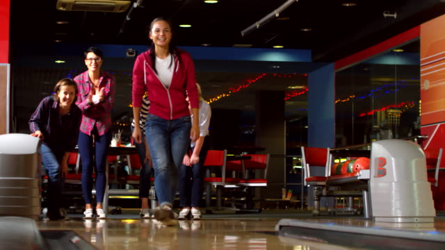 Happy Women Playing Bowling Together