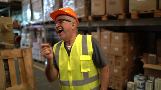 Happy worker dancing inside distribution warehouse Happy worker dancing inside distribution warehouse manufacturing occupation stock videos & royalty-free footage