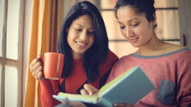 happy young adult female students studying together. - two students together asian video stock e b–roll