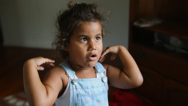 Happy Young Australian Aboriginal Girl Learning to Sing and Dance to a Song video