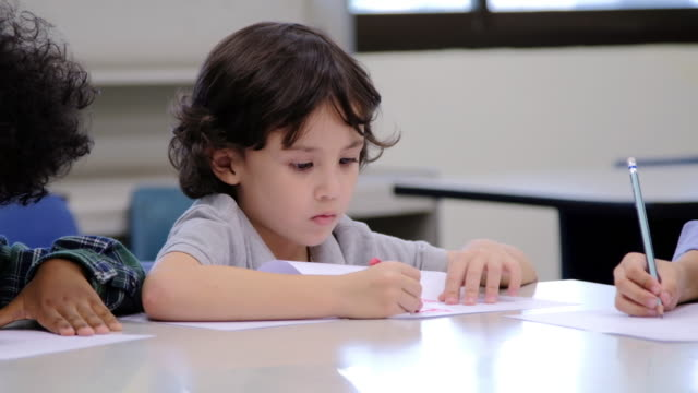 Happy young boy drawing, video