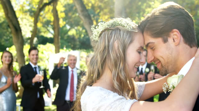happy young bride and groom hugging each other 4k 4k - matrimonio video stock e b–roll