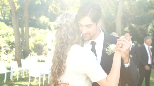 Happy young bride and groom hugging each other while dancing 4K 4k video