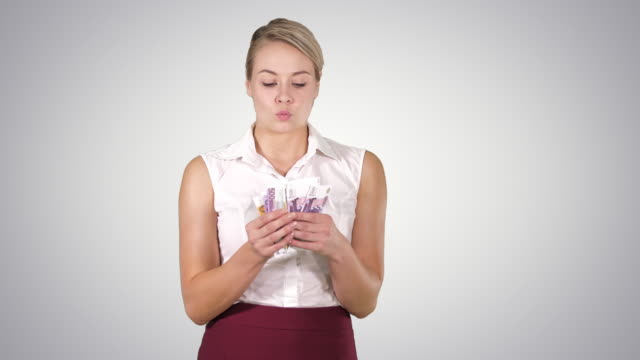 Video Happy young businesswoman holding fan of euro notes, Alpha Channel