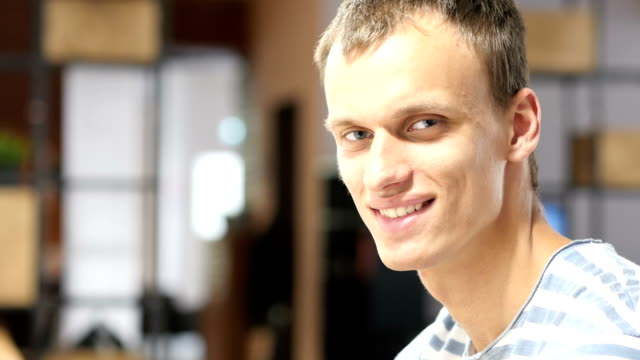 Happy young Confident man Smiling at Work, Portrait video