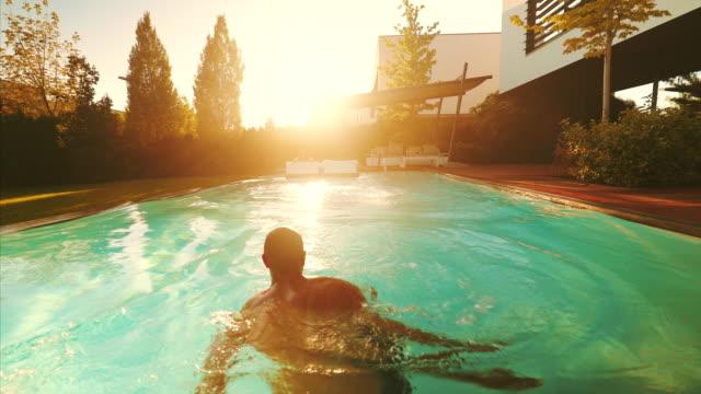 vídeos de stock e filmes b-roll de happy young couple enjoying a beautiful summer day. - enjoying wealthy life