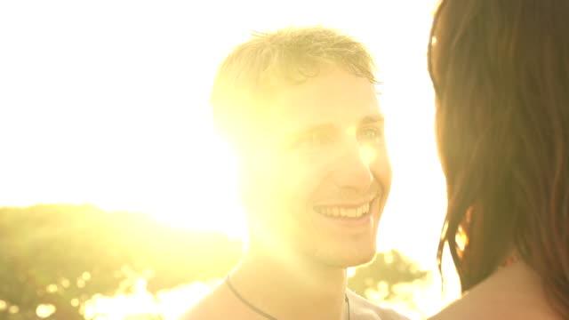 slow motion: happy young couple in love at sunset - djurarm bildbanksvideor och videomaterial från bakom kulisserna