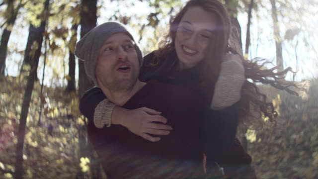 Happy young man piggybacking his girlfriend video