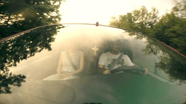 Happy young men riding a car video