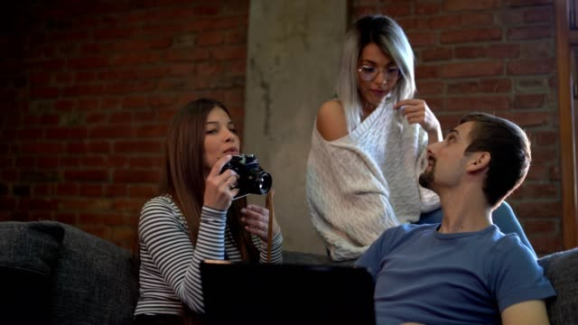 happy young people with camera photographing at home - miroslav mitic stock videos and b-roll footage