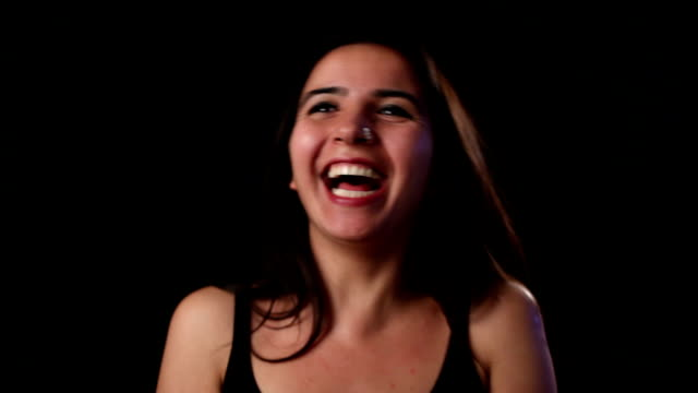 Happy young woman laughing video