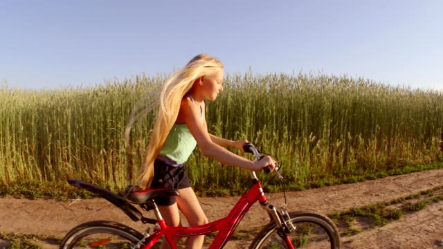 Happy Young Woman Smiling Laughing Riding Bicycle Slow Motion video