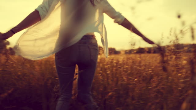 Happy Young Woman Spinning Around on a Meadow video