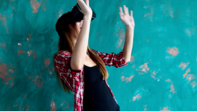 Happy young woman with virtual reality headset video