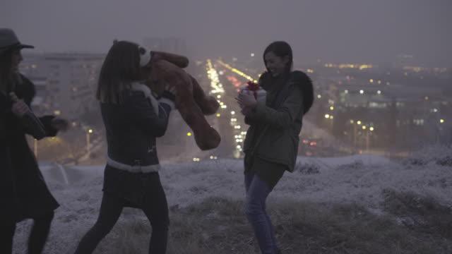 happy young women having fun outdoors. - happy holidays filmów i materiałów b-roll