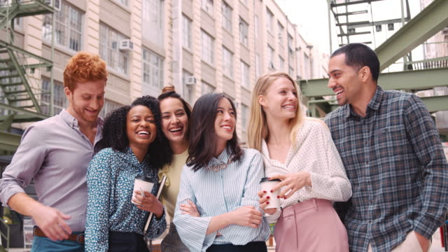 happy young work colleagues hang out outside their workplace - generazione y video stock e b–roll