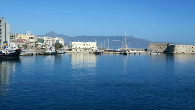 harbor of iraklion on crete (greece). ships and boats in the harbor right next to the historical town part of iraklion with its fort. - cavalla video stock e b–roll