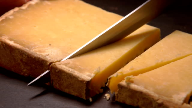 Hard French Parmesan cheese cut into triangles video