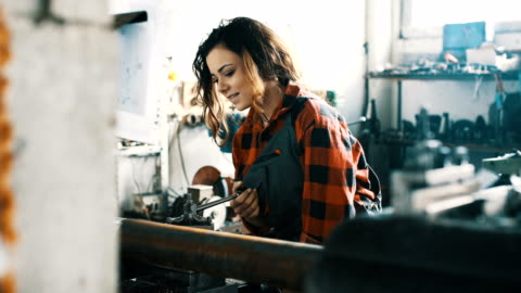 Hard work 4K Mechanic girl .Girl in a workshop on the machines craft stock videos & royalty-free footage