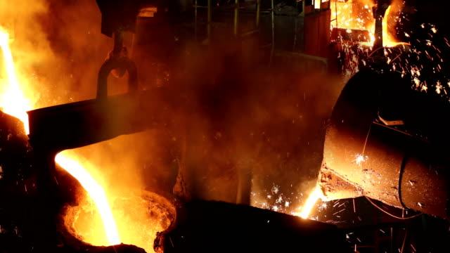 hard work in foundry - industria metallurgica video stock e b–roll