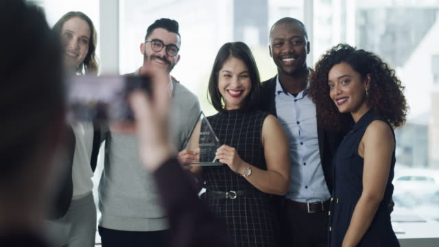 Hard work will earn you plenty of rewards 4k video footage of a group of businesspeople taking a photograph during an awards ceremony contest stock videos & royalty-free footage
