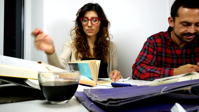 Hardworking girl and rude boy study together video