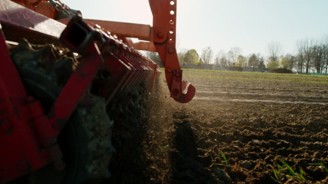 SLO MO Harrow smoothing and breaking up the soil Super slow motion shot of a harrow breaking up the soil while cultivating the field. harrow agricultural equipment stock videos & royalty-free footage